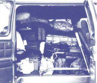 van filled with luggage and supplies