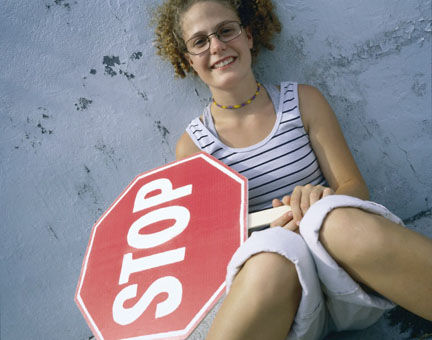 girl with stop sign